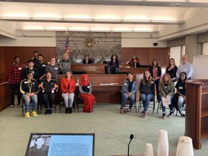 Henninger High School students, with United States District Judge Brenda K. Sannes