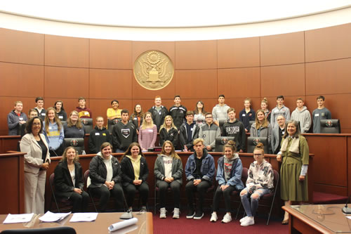McGraw High School and Tully High School students, with Chief United States Bankruptcy Judge Margaret Cangilos-Ruiz and United States Magistrate Judge Therese Wiley Dancks